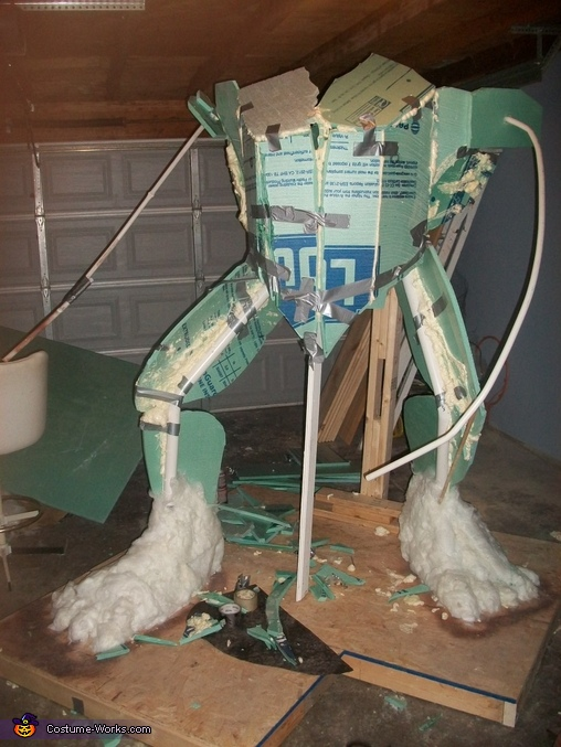 I had to build an armature first.  Pic is 3 days into the build. I used styrofoam, expandable foam, and PVC to build the frame. I began adding insulation to the frame. (note the fuzzy feet), The Incredible Hulk Costume