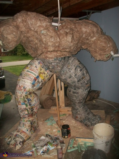 Day 7: I began adding paper mache (glue, flour and water to newspaper) to the insulation. It's at this point I realized I made the shoulders too wide. Many alterations soon followed., The Incredible Hulk Costume