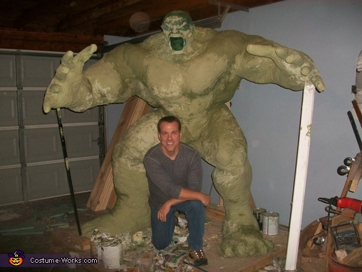 Day 19: 'Monster mud' was added to paper mache to strengthen the armature. (MM is five parts dry wall putty one part exterior latex paint. In this case...green.)  I had placed a temporary head made of foam to give me an idea where the neck muscles will go, The Incredible Hulk Costume