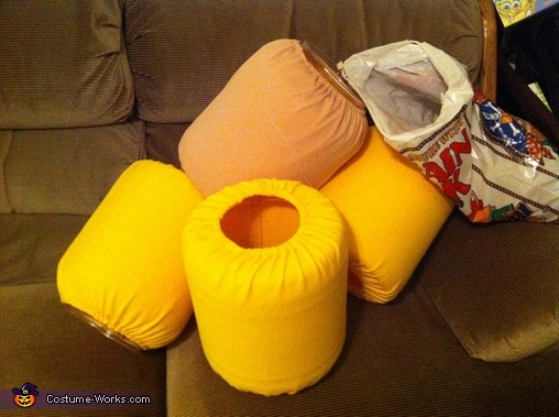 LEGO heads (over empty cheese ball containers) with slip covers waiting to be sewn., Everything is Awesome The LEGO Movie Costume