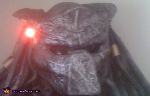 use silver enamel sparay paint and small brush dust over entire mask to give old metal effect place sunglass lenses in eyes , air conditionig covering for hair pvc pipe peaces for metal bands in hair, The Predator Costume