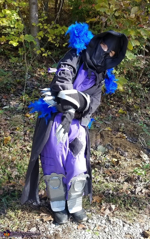 Doing a dance move from fortnite, The Raven Costume