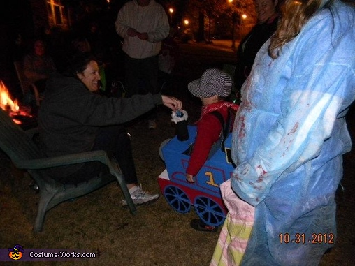 Putting candy down the steam stack, Thomas the Train Costume