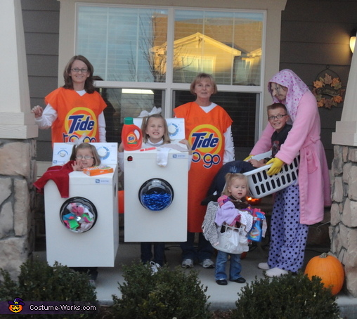 The 'Tide To Go' girls standing with the rest of the 'Cleaning Crew'., Tide to Go Sticks Costume