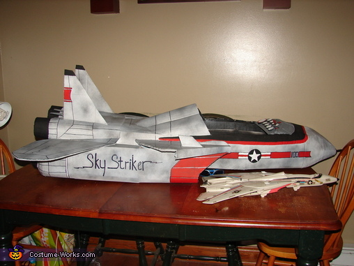 Plane next to model Top Gun Fighter Plane, Jet Pilot Maverick and his Top Gun Fighter Jet Costume
