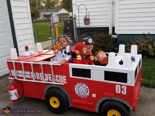 Two Firemen and their Dalmatian Costume
