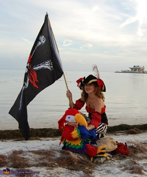 A pirate and her parrot on the shore, Two Pirates and a Parrot Family Costume