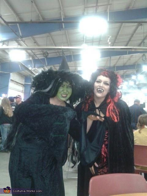 on the right with the red and black wig, Vampiress Costume