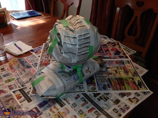 The process started by building a paper model head and shoulders the size of my daughter., Water Dragon Costume