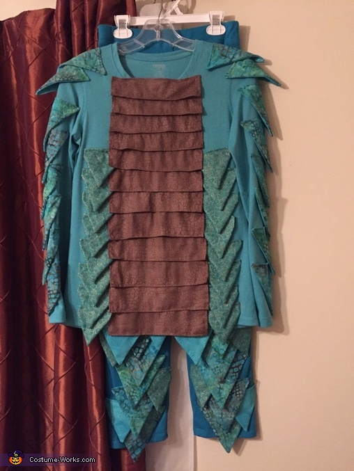 Next came the process of finding material that could be used to sew scales together.   About 100 scales had to be hand made to cover the outside of the costume., Water Dragon Costume