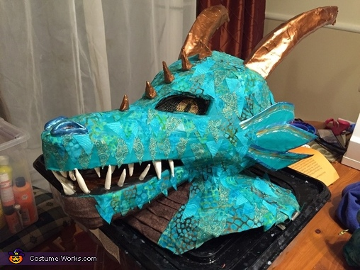 Final painted head.  We used some of the same material we used for the scales and glued them on the outside of the head to make all of the scale match.  Clay was used for the teeth, spikes and nostrils., Water Dragon Costume