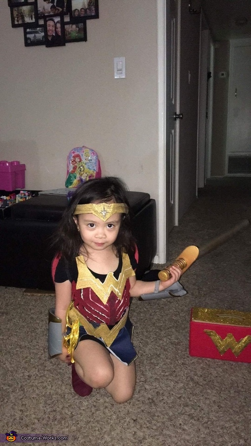 Down to her knees posing, Wonder Woman Costume