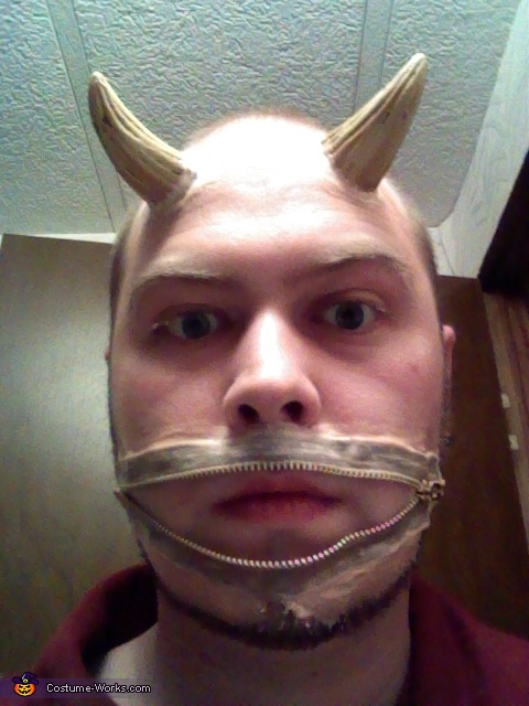 Using spirit gum, adhere the zipper to your face in the desired position.  It doesn't have to be perfectly on, just enough to hold it to your face so that you can paint the liquid latex on in order to get make it semi permanent. Do the same with the horns, Zipper Mouth Demon Costume