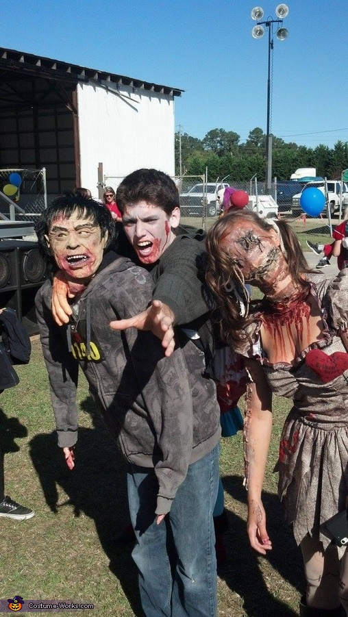 Photo after the 5k, the zombie won by a head., Zombie carrying split in half Zombie on its back Costume