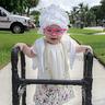 Photo #2 - Boca Raton Florida's newest retiree Olivia Ryan enjoying a stroll through the neighborhood.