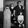 Photo #1 - Standing L-R: Cousin Itt, Wednesday, Gomez.  Seated L-R: Morticia and Pugsley