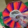Photo #5 - Here I finished hot gluing colorful tule underneath the mushroom cap.