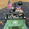 Photo #1 - Army soldier with army ride on jeep