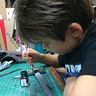 Photo #7 - Connor painting the skeleton sword