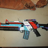 Photo #4 - The guns in the Borderlands games are very colorful and futuristic. I found a regular toy gun at a costume store and painted it to match the style.
