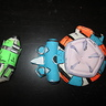 Photo #5 - These are accessories the character wears in game. One is a shield (a force field of sort that blocks enemies shots temporarily), and a grenade. These were sculpted entirely with crayola model magic, and painted with acrylics. They even glow in the dark!