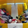 Photo #3 - This is an up close picture of the in side of the claw machine.