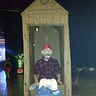 Photo #5 - Cletus in an Outhouse