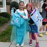 Photo #2 - Elsa and Anna posing with their matching candy bags.