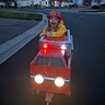 Photo #2 - Penny so excited in her fire truck for the first time!