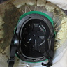 Photo #9 - The inside of the head showing the helmet that was tied to the head