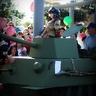 Photo #1 - Carrington rolling into battle in her tank.