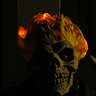 Photo #5 - Dark, but a night view of the glowing flames and close up of the mask.