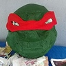 Photo #6 - The head was then painted green with acrylics.  For the eyes we used starbuck plastic and painted the iris.  For the mask/bandana red felt was used