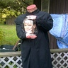 Photo #1 - Headless man with head in a jar