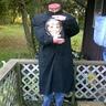 Photo #4 - Headless man with head in a jar