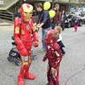 Photo #3 - A junior Iron Man looks up in awe in the Halloween parade.