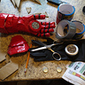 Photo #2 - Building materials for the gloves; paper, rubber gloves, touch lights, duct tape, cardboard