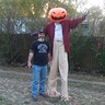 Photo #1 - 8' tall pumpkin head jack skellington, above the rest