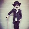 Photo #7 - Charlie Chaplin A perfect model to pull off a simple look. Pefect suit, wig with a slight wave, an endless search for a cheap hat close enough to mimic Charlies, some white face paint to dull her out like a silent movie. Cane=perfect thrift shop find.