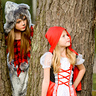 Photo #1 - Big Bad Wolf spies an unsuspecting Little Red Riding Hood!