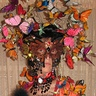 Photo #2 - This is the head piece with over 70 butterflies attached to wires then wrapped around metal combs and placed in a geisha style wig