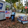 Photo #2 - Mail Carrier and Postage Stamp