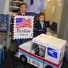 Photo #1 - Mail Carrier and Postage Stamp