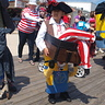 Photo #1 - A Little Minion Carrying a Treasure Chest with a Pirate In It