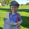 Photo #2 - Mason (King of New York) sharing news about the Newsies strike of 1899.
