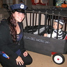 Photo #1 - Police Officer and Inmate