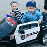 Photo #1 - Police Officer and Prisoner