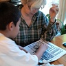 Photo #4 - Grandma cuts stencils using templates from the Internet