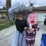 Photo #1 - Mama and me in the driveway handing out candy.