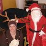 Photo #1 - Santa pets reindeer